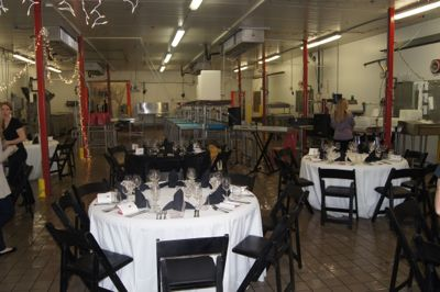 Pop-Up Restaurant Event with dining tables and chairs in factory
