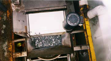 fasteners that have come off of conveyor system